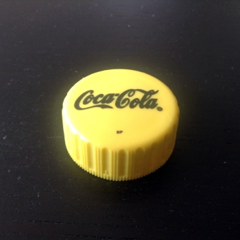 Coke Botle Cap from Zambia, in Yellow.