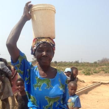Maggie transporting water